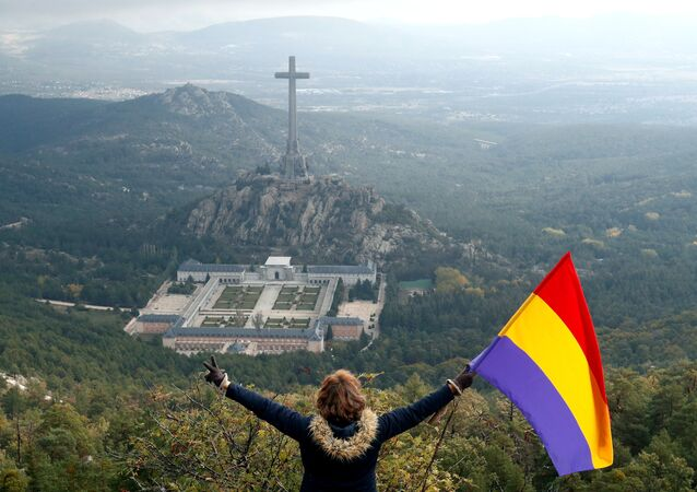Belen Perez holds a Republican flag near the Valle de los Caidos (The Valley of the Fallen) in Spain