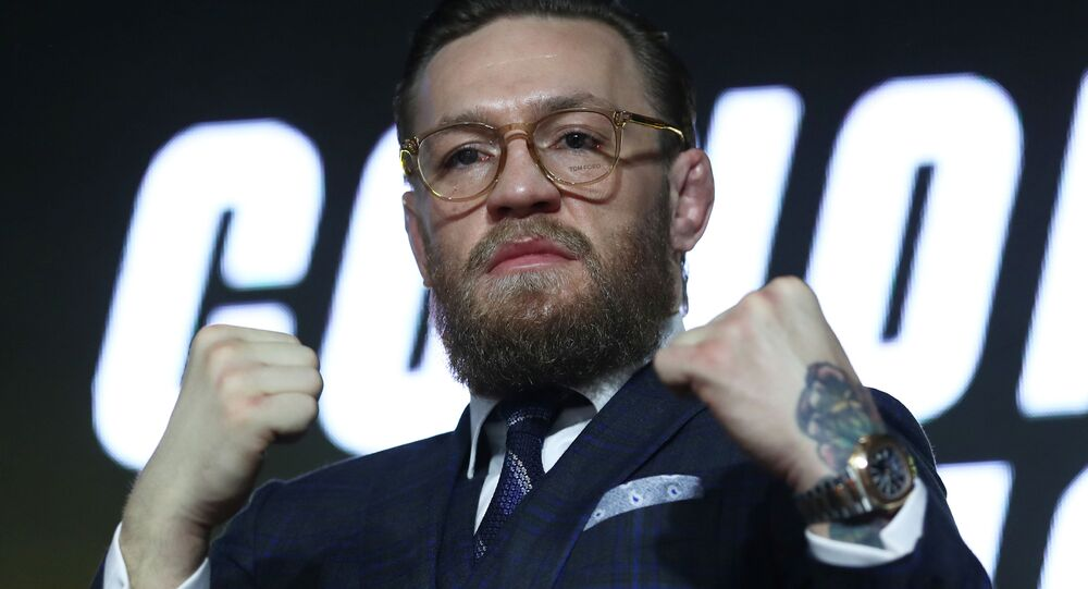 Mixed martial arts (MMA) fighter Conor McGregor gestures during a news conference in Moscow, Russia, October 24, 2019
