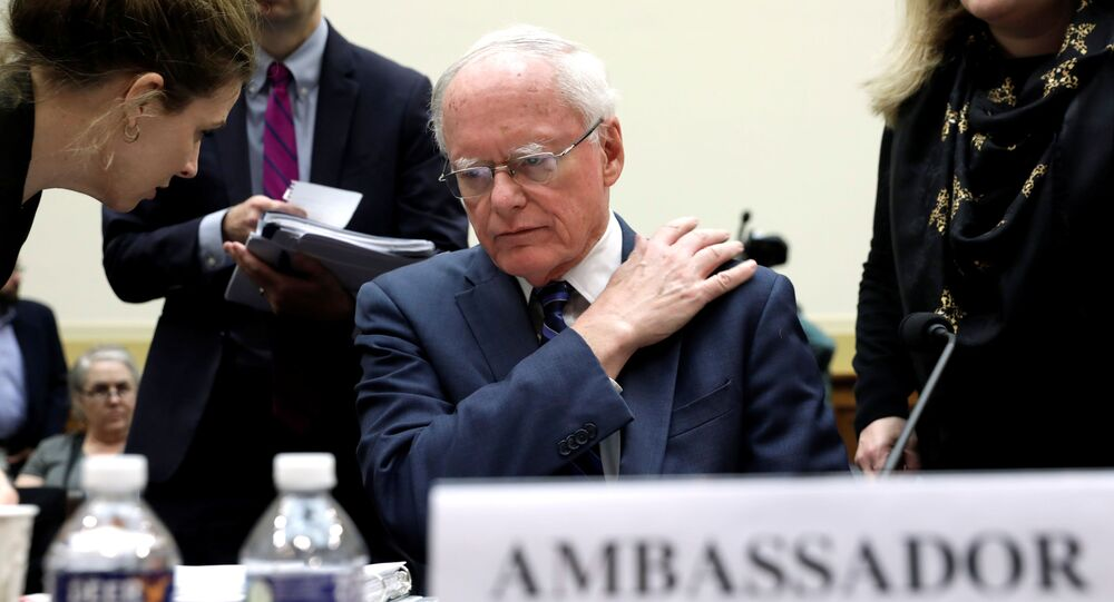 James Jeffrey, U.S. State Department special representative for Syria Engagement, listens to his aide before a House Foreign Affairs Committee hearing on President Trump's decision to remove U.S. forces from Syria, on Capitol Hill in Washington, U.S., October 23, 2019