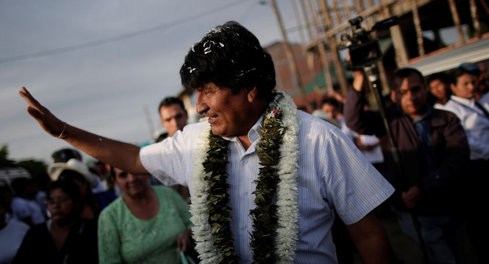 Bolivia's President and presidential candidate Evo Morales of the Movement Toward Socialism (MAS) party is greeted by supporters as he arrives to vote during the presidential election at a polling station in a school in Villa 14 de Septiembre, in the Chapare region, Bolivia, October 20, 2019.