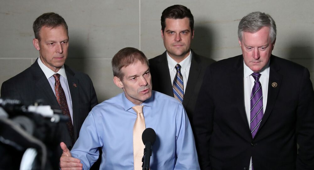 U.S. Representative Jim Jordan (R-OH) leads fellow Republicans, including Rep. Scott Perry (R-PA), Rep. Matt Gaetz (R-FL) and Rep. Mark Meadows (R-NC), as he speaks to reporters outside the House Intelligence Committee offices on Capitol Hill in Washington, U.S. October 8, 2019