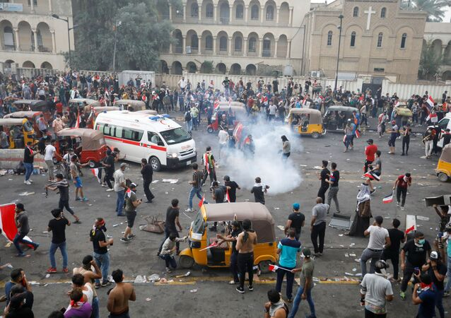 Demonstrators disperse as Iraqi Security forces use tear gas during a protest over corruption, lack of jobs, and poor services, in Baghdad, Iraq October 25, 2019