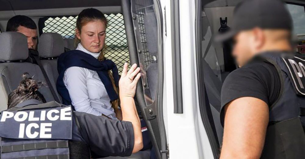 Convicted Russian Maria Butina is accompanied by federal agents after her release from a Florida prison, during her transfer onto a jet bound for Moscow at Miami International Airport in Miami, Florida, U.S. October 25, 2019.