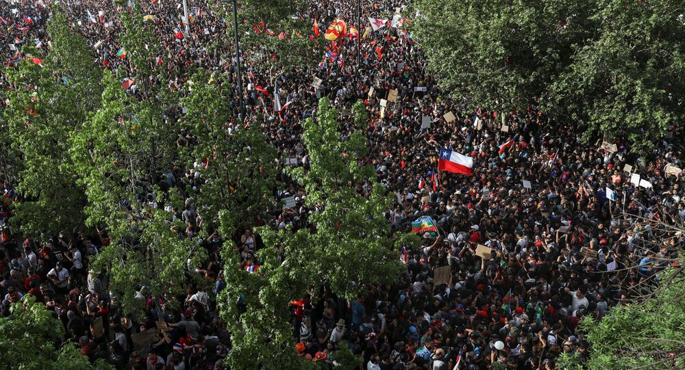 An aerial view shows demonstrators gathering during a protest against Chile's state economic model in Santiago, Chile October 25, 2019.