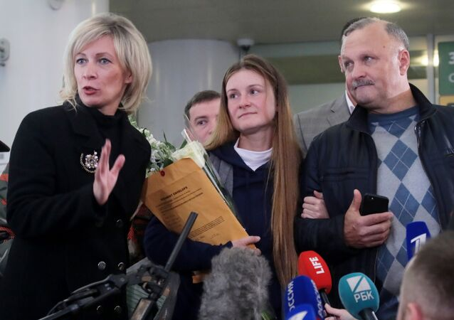 Russian Foreign Ministry's spokeswoman Maria Zakharova, convicted Russian agent Maria Butina, who was released from a Florida prison and then deported by U.S. immigration officials, and her father Valery Butin speaks to the media upon Butina's arrival at Sheremetyevo International Airport outside Moscow, Russia.