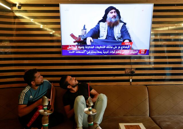 Iraqi youth watch the news of Islamic State leader Abu Bakr al-Baghdadi death, in Najaf, Iraq October 27, 2019.