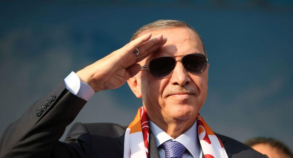 Turkish President Tayyip Erdogan salutes during a gathering in Kayseri, Turkey, October 19, 2019.