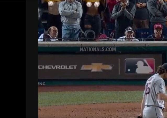 Women flash Houston Astros pitcher during Game 5 of the World Series