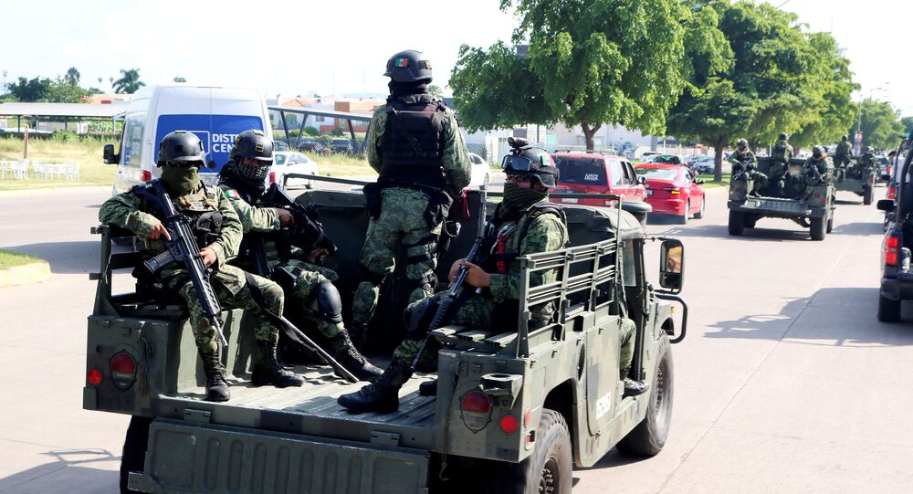 Members of a special unit of the Mexican Army conduct a patrol as part of an operation to increase security after cartel gunmen clashed with federal forces, resulting in the release of Ovidio Guzman from detention, the son of drug kingpin Joaquin El Chapo Guzman, in Culiacan, in Sinaloa state, Mexico October 19, 2019