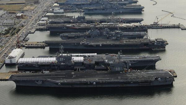 Dec. 20, 2012: The aircraft carriers USS Dwight D. Eisenhower (CVN 69), USS George H.W. Bush (CVN 77), USS Enterprise (CVN 65), USS Harry S. Truman (CVN 75), and USS Abraham Lincoln (CVN 72) are in port at Naval Station Norfolk, Va., the world's largest naval station. - Sputnik International