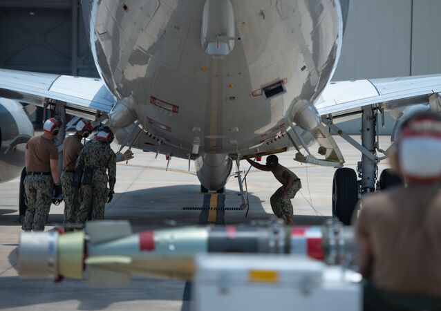Aviation Ordnanceman 3rd Class Jermain Snowden, assigned to Patrol Squadron (VP) 30, prepares to load a Mark 54 Torpedo onto a P8-A Poseidon aircraft during a training exercise at Naval Air Station Jacksonville