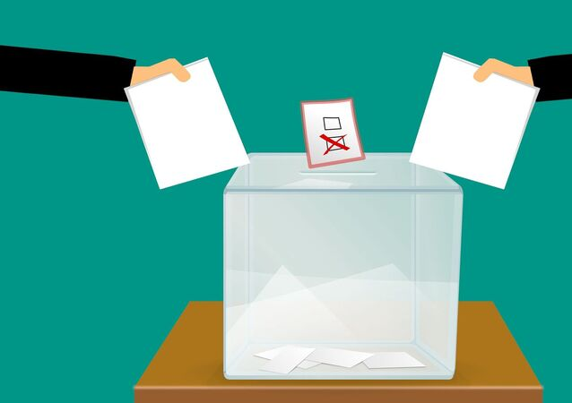 Votes going in a ballot box