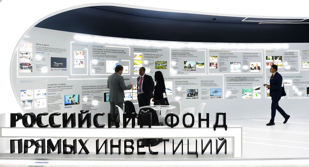People visit the stand of the Russian Direct Investment Fund (RDIF) during the St. Petersburg International Economic Forum (SPIEF)