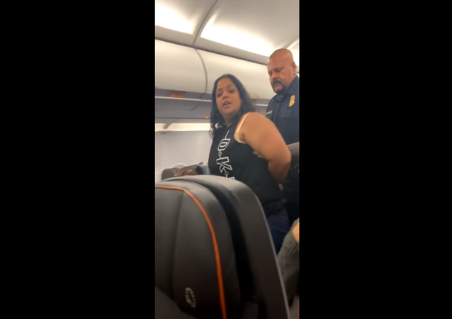 An unidentified JetBlue passenger is removed from a New York City-bound flight after making several claims that the plane was going to crash, and that it had already gone down into the water.