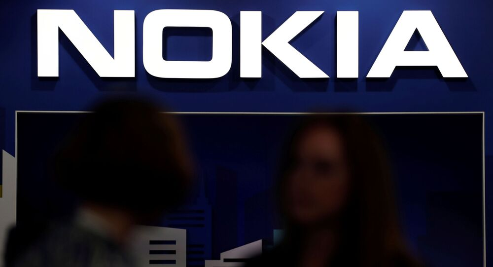 FILE PHOTO: Visitors gather outside the Nokia booth at the Mobile World Congress in Barcelona, Spain, 26 February 2019