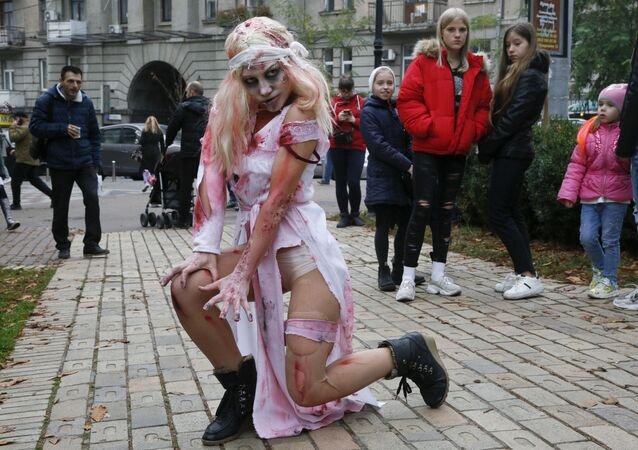 A person dressed as a Zombie poses for a photo as she participates in a 'Zombie Walk' on the weekend before Halloween in central Kiev, Ukraine Saturday, Oct. 26, 2019.