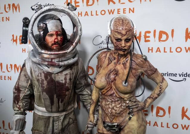 Tom Kaulitz, left, and Heidi Klum in their costumes attend her Halloween party at Cathedrale on Thursday, Oct. 31, 2019, in New York