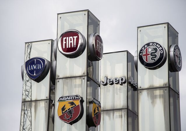 A car dealership in Turin shows off the logos of brands owned by Fiat Chrysler Automobiles
