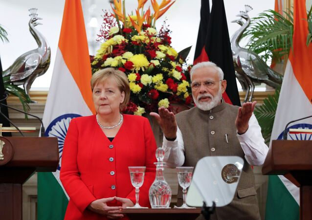 German Chancellor Angela Merkel and India's Prime Minister Narendra Modi are seen before making a joint statement at Hyderabad House in New Delhi, India, November 1, 2019