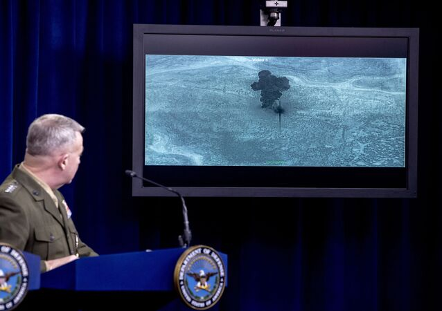 Video of the Abu Bakr al-Baghdadi raid is displayed as US Central Command Commander Marine Gen. Kenneth McKenzie speaks, Wednesday, Oct. 30, 2019, at a joint press briefing at the Pentagon in Washington.