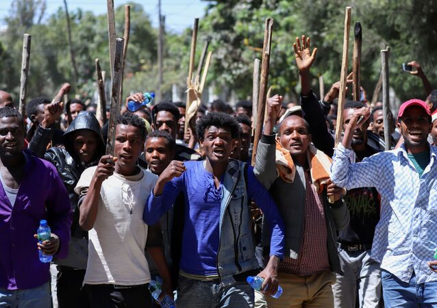 FILE PHOTO: Oromo youth chant slogans during a protest in-front of Jawar Mohammed's house, an Oromo activist and leader of the Oromo protest in Addis Ababa, Ethiopia, October 24, 2019