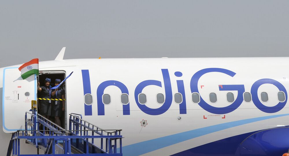 (FILES) In this file photograph taken on March 16, 2016, crew members of an IndiGo Airbus A320 aircraft wave an Indian national flag at The India Aviation 2016 airshow at Begumpet Airport in Hyderabad. Airbus announced on October 29, 2019, that India's IndiGo have ordered 300 A320neo aircraft.