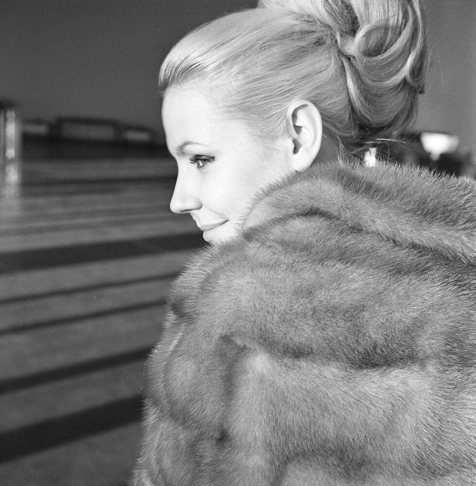 Model wears a blue mink cape (1965)