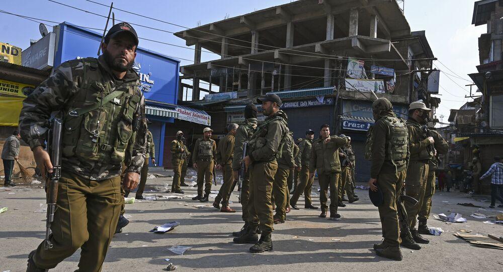 Soldiers evacuate an injured comrade after a grenade blast at a market in Srinagar on November 4, 2019.