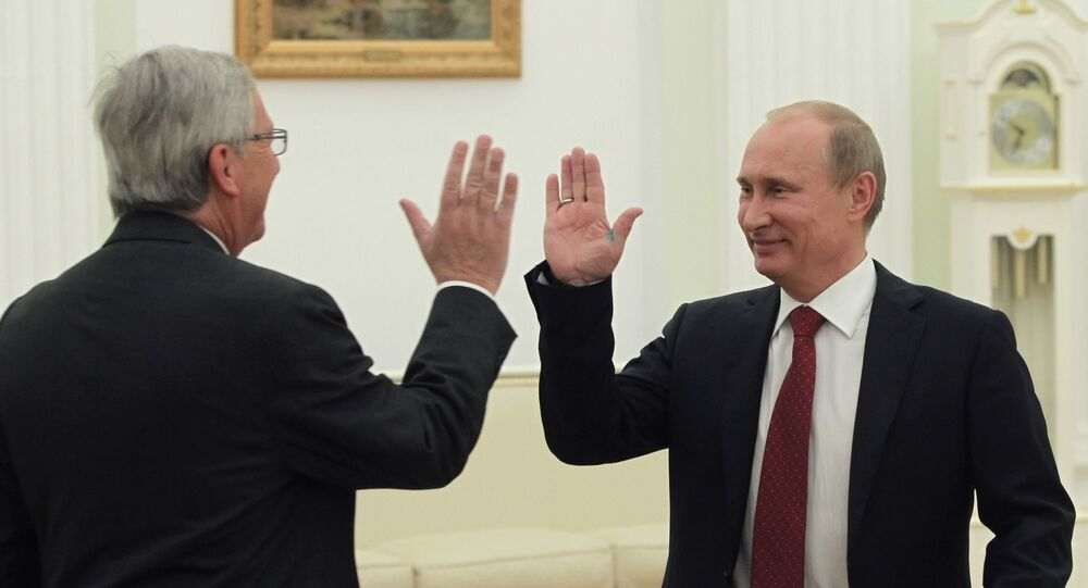 Russia's President Vladimir Putin (R) meets Luxembourg Prime Minister and Eurogroup president Jean-Claude Juncker in Moscow on September 25, 2012. Jean-Claude Juncker is on a working visit to Russia.