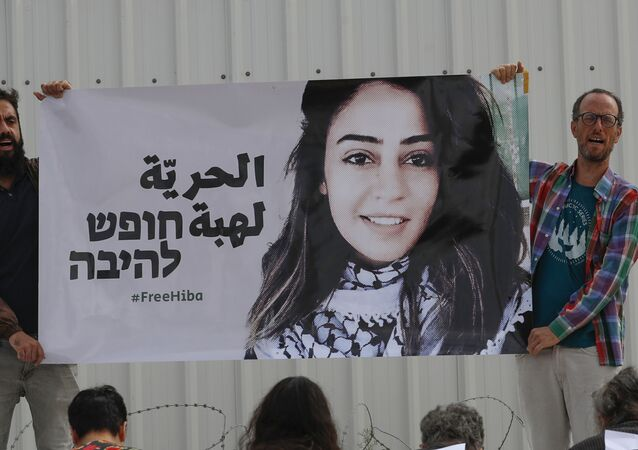 Israeli activists protest in solidarity with Jordanian Heba al-Labadi (portrait), who is currently in Israeli custody and has been on hunger strike, outside Ofer Prison during her court hearing in the Israeli-occupied West Bank on October 28, 2019.