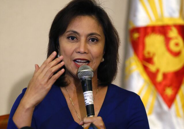 FILE - In this Dec. 5, 2016 file photo, Philippine Vice President Leni Robredo answers questions from the media during a news conference following her resignation from her cabinet post under President Rodrigo Duterte in suburban Quezon city, south of Manila, Philippines