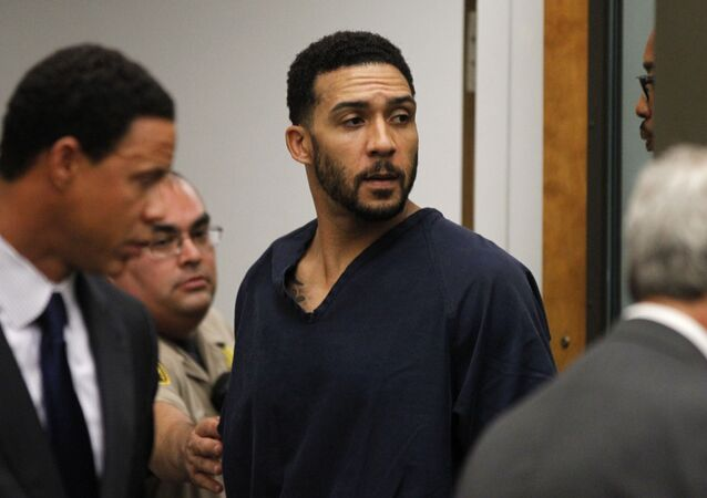 Former NFL football player Kellen Winslow Jr., center, leaves his arraignment Friday, June 15, 2018, in Vista, Calif.