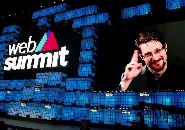 Edward Snowden gestures as he speaks via livestream at Web Summit in Lisbon, Portugal, November 4, 2019