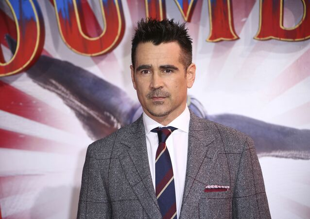 Actor Colin Farrell poses for photographers upon arrival at the premiere of the film 'Dumbo' in London, Thursday, March 21, 2019