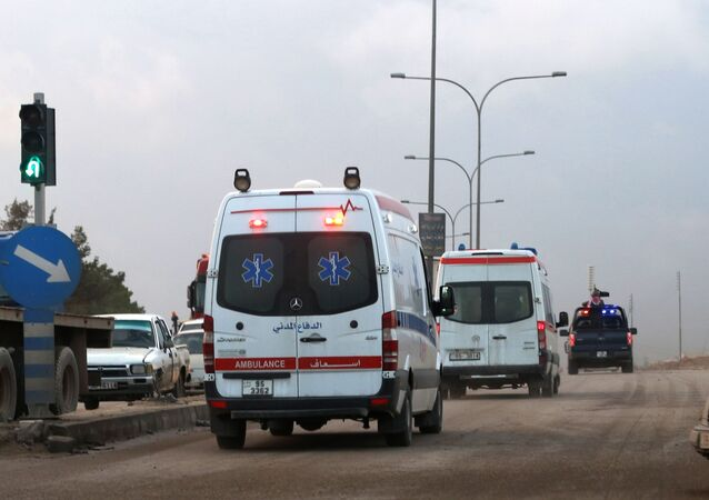 Ambulances leave the King Abdullah bin Al Hussein Training Center where a Jordanian policeman went on a shooting spree in Mwaqar on the outskirts of Amman, Jordan, Monday, Nov. 9, 2015