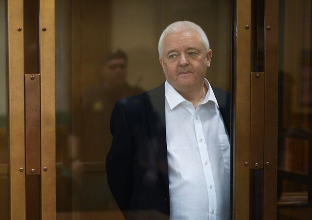 Norway's Frode Berg waits in a cage in a court room in Moscow, Russia