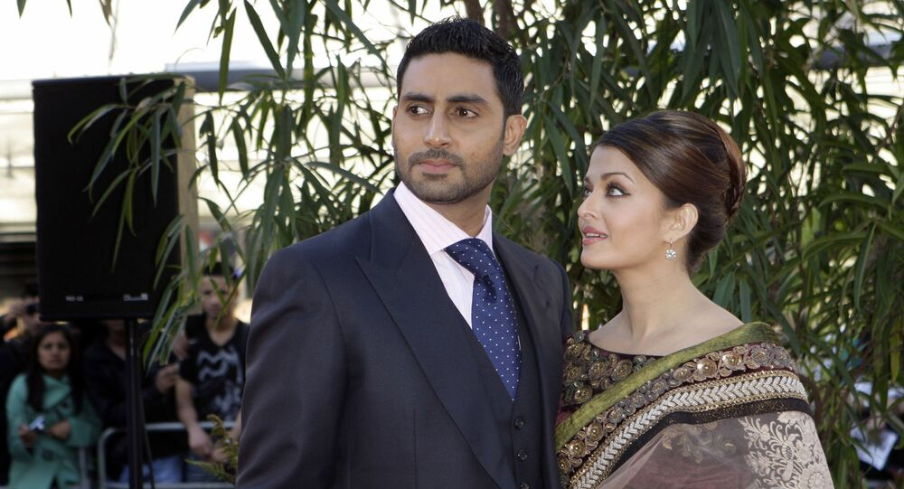 Indian actors Aishwarya Rai Bachchan, right, and husband Abhishek Bachchan arrive on the red carpet for the World Premiere of the film Raaven, at the BFI, British Film Institute, in London, Wednesday, June 16, 2010