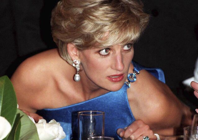 In this photo, taken 31 Oct. 31, 1996, Diana, Princess of Wales, attends the Victor Chang charity dinner in Sydney, Australia, wearing an emerald cut aquamarine ring which Meghan Markle was wearing when she left Windsor Castle after her wedding to Prince Harry on Saturday, 19 May, 2018