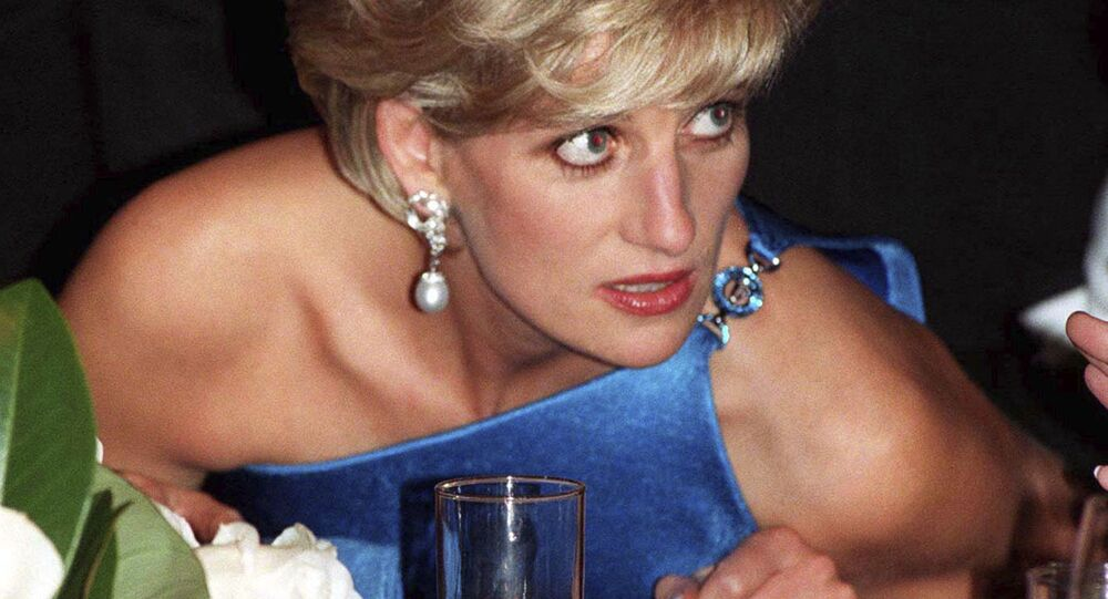 In this Oct. 31, 1996 file photo, Diana, Princess of Wales, attends the Victor Chang charity dinner in Sydney, Australia, wearing an emerald cut aquamarine ring which Meghan Markle was wearing when she left Windsor Castle after her wedding to Prince Harry on Saturday, May 19, 2018