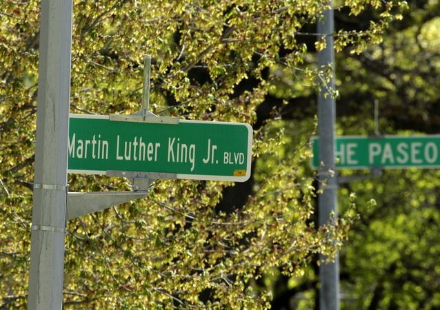 A newly changed sign for Dr. Martin Luther King, Jr. Boulevard stands in contrast to a yet-to-be changed sign for The Paseo in Kansas City
