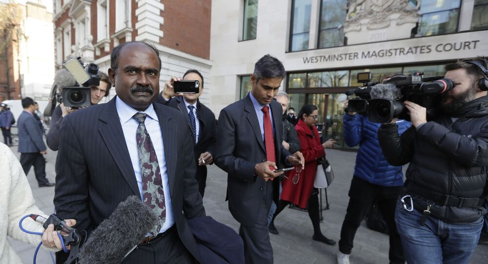Officials are filmed by the media as they leave court after Indian diamond tycoon Nirav Modi was denied bail at Westminster Magistrates Court in London, Friday, March 29, 2019