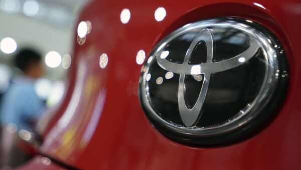 FILE - In this Aug. 2, 2019, file, photo, people walk by the logo of Toyota at a show room in Tokyo - Sputnik International