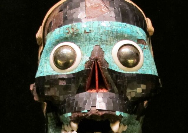An Aztec mask decorated with turquoise mosaic, 1400-1521