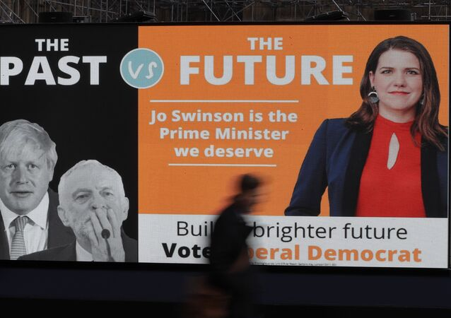 A pedestrian passes the launch of the Liberal Democrats party's General Election slogan on 31 October 2019.
