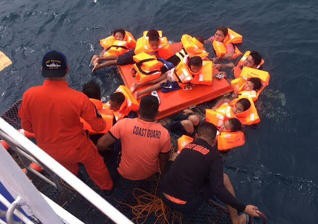 This handout photo taken and released on November 7, 2019 by the Philippine Coast Guard shows passengers of the ill-fated MV Siargao Princess ferry after being rescued from the waters off Sibunga Cebu in the central Philippines. - Philippine authorities launched a rescue operation on November 7 after a ferry with at least 60 people onboard capsized in rough seas, the coast guard said. (Photo by Handout / Philippine coast Guard (PCG) / AFP) /