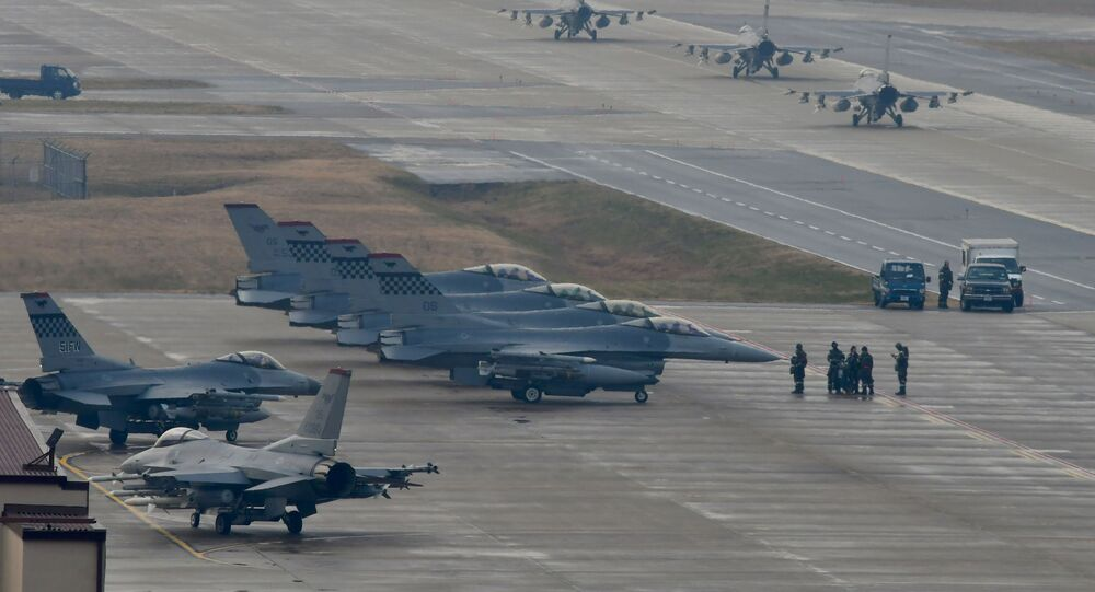 U.S. Air Force F-16 Fighting Falcon fighter aircraft, assigned to the 36th Fighter Squadron, participate in an elephant walk during Exercise VIGILANT ACE