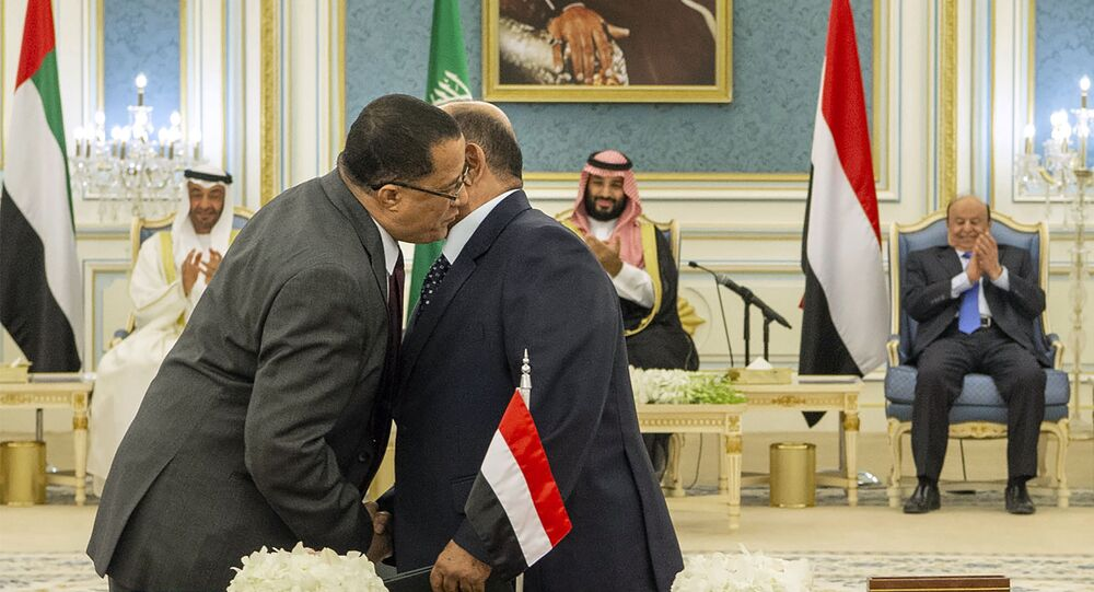 Yemeni Southern Transitional Council member and former Aden Governor Nasser al-Khabji, left, and Yemen's deputy Prime Minister Salem al-Khanbashi greet each other before signing a power-sharing deal witnessed by Yemen's president, Abed Rabbo Mansour Hadi