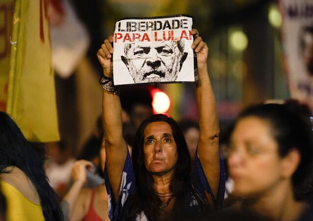 A woman holds up a sign that reads in Portuguese Freedom for Lula, referring to former jailed president Luis Inacio Lula da Silva, during a protest against Brazil's president Jair Bolsonaro to demand an investigation into the 2018 murder of city councilwoman Marielle Franco in Rio de Janeiro, Brazil, Tuesday, Nov. 5, 2019.
