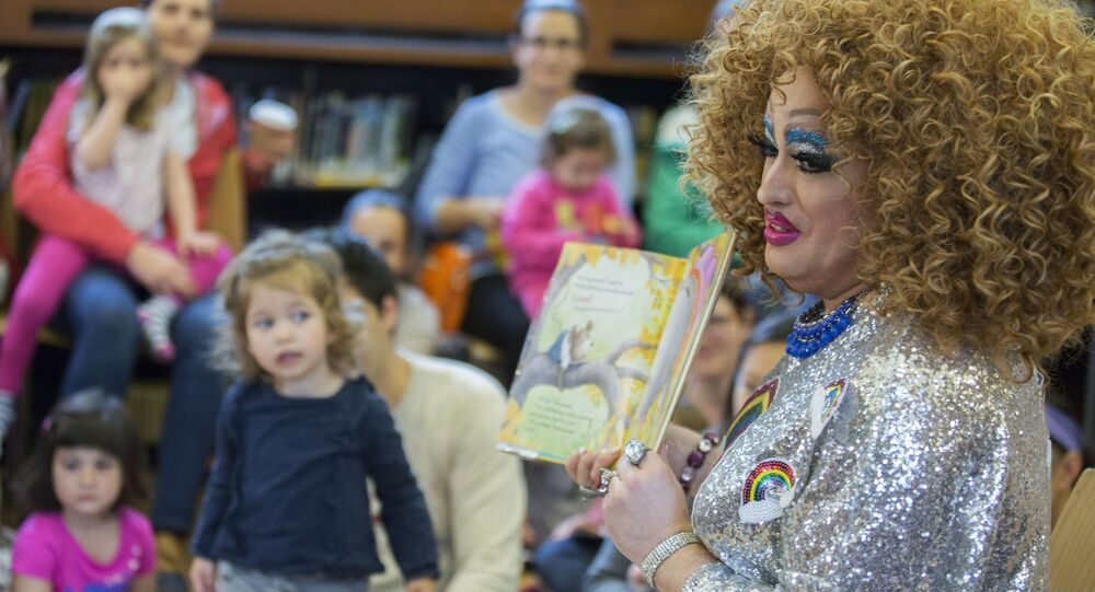In this Saturday, 13 May 2017 photo, Lil Miss Hot Mess reads to children during the Feminist Press' presentation of Drag Queen Story Hour at the Park Slope Branch of the Brooklyn Public Library, in New York