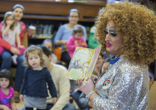 In this Saturday, May 13, 2017 photo, Lil Miss Hot Mess reads to children during the Feminist Press' presentation of Drag Queen Story Hour at the Park Slope Branch of the Brooklyn Public Library, in New York